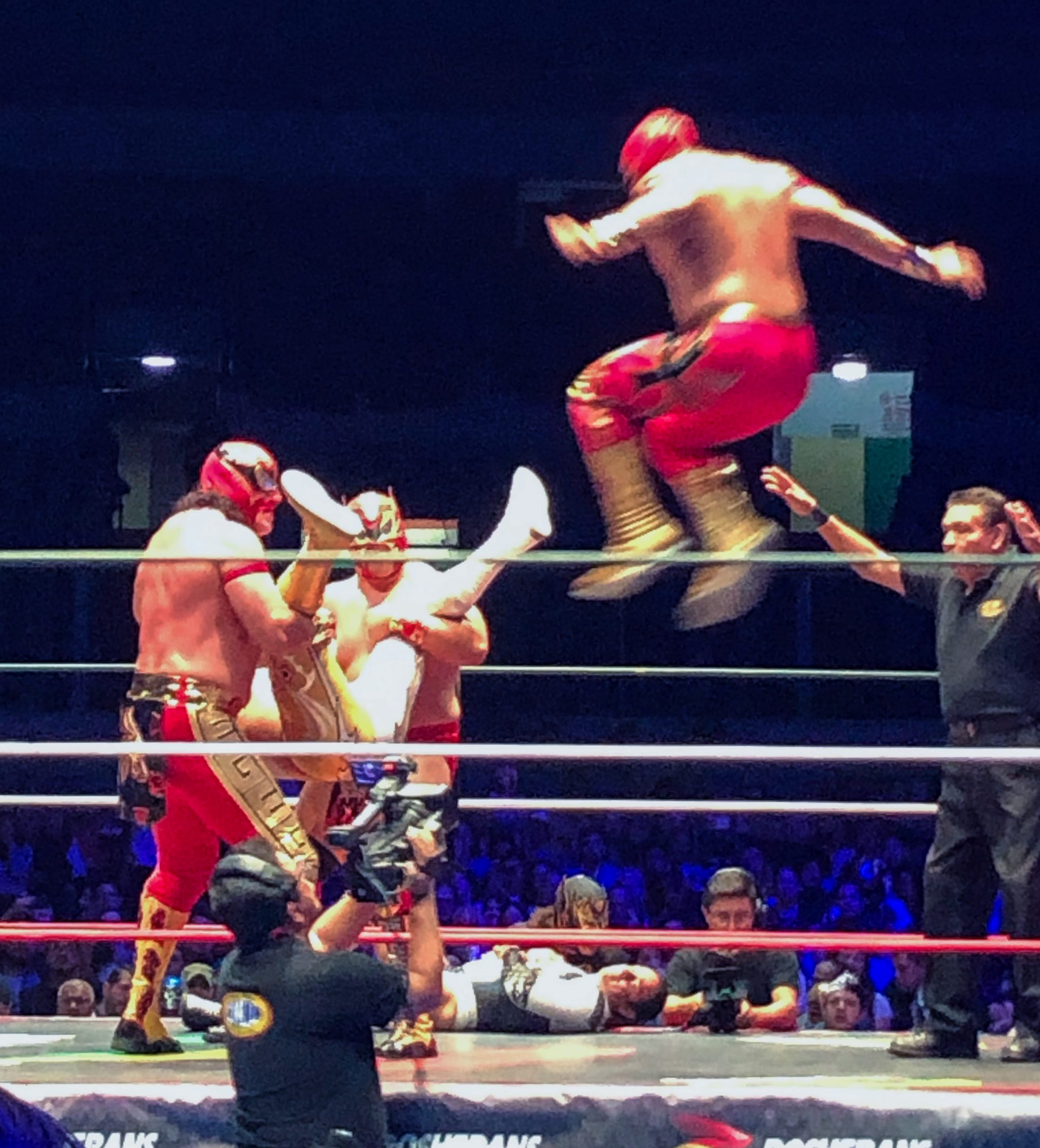 Luchador jumping onto opponent