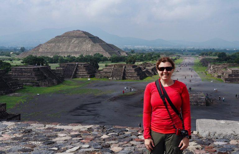 Amber on Moon Pyramid with Sun Pyramid behind at Teotihuacan
