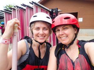 Amber and Desi wearing rafting helmets