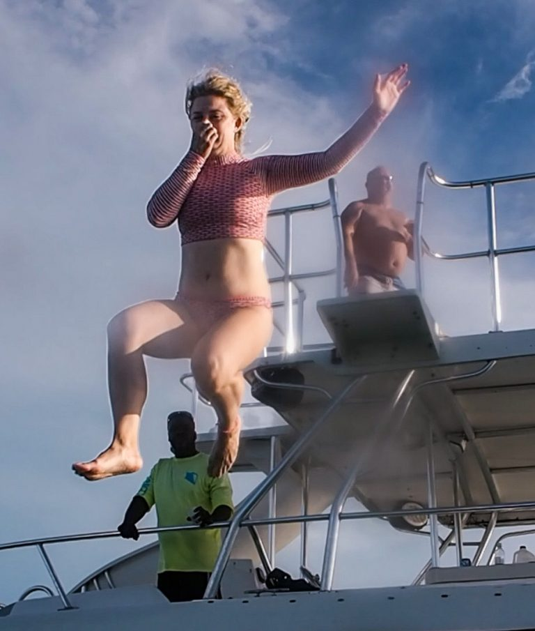 Desiree jumping off the boat in Turks and Caicos