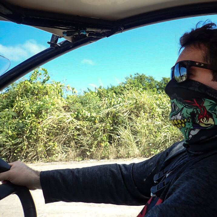 Chris driving a dune buggy in St Kitts