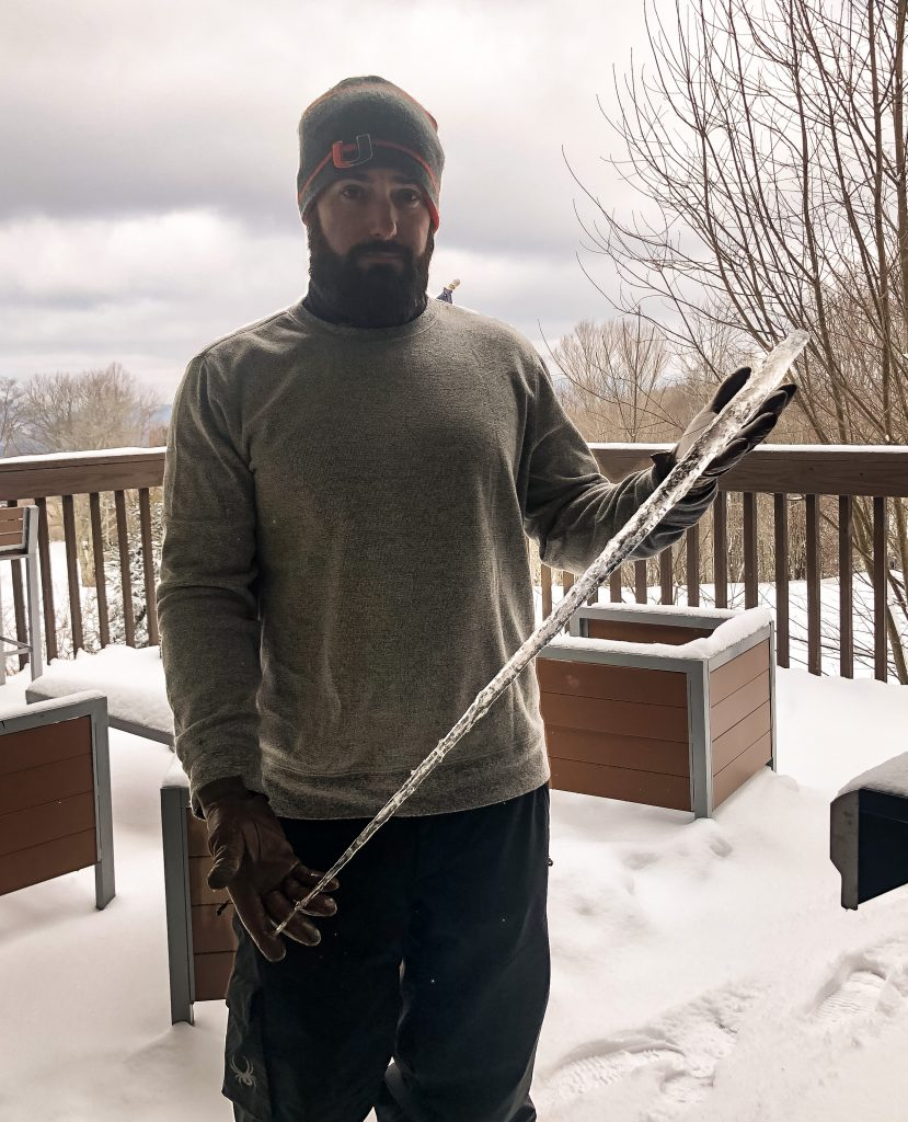 Chris holding a giant icicle