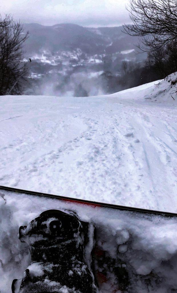 Looking down slope on snowboard at Sugar Mountain Resort