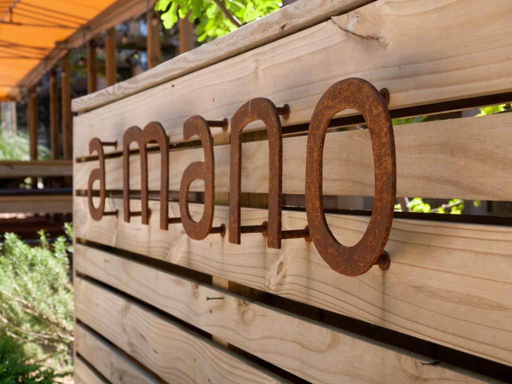 Sign at A Mano Restaurant O4W